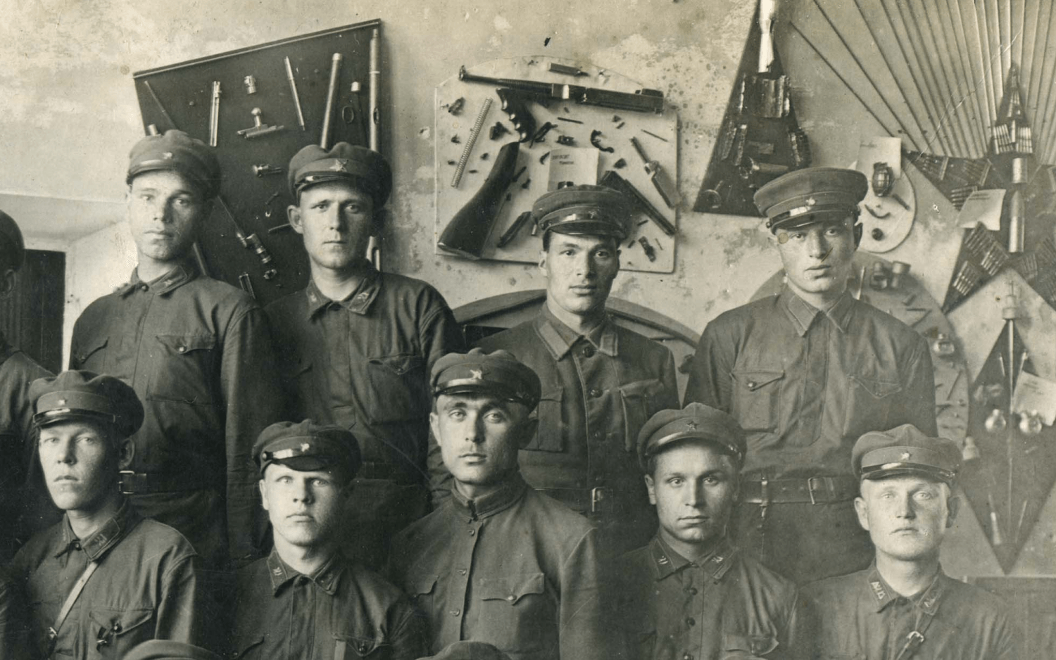 """""""Display board"""" with a Thompson gun is right behind the soldiers."""