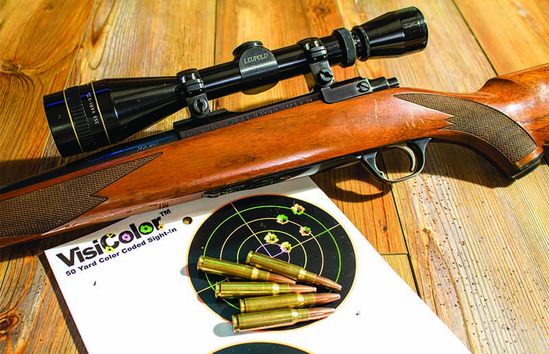 The author's .308 Winchester and a 1.5-MOA group. This rifle has taken many different species, even though it isn't the most accurate.